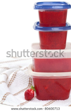 Fresh Homemade Freezer Strawberry Jam in Containers with Room for Wording - stock photo
