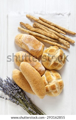 fresh homemade Italian bread: ciabatta, wholemeal, turtle, gressini. breadsticks with sesame seeds. and lavender - stock photo
