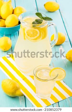 Fresh homemade lemonade.  Shallow depth of field. - stock photo