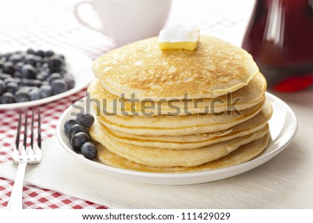 Fresh Homemade Pancakes with Syrup on a background