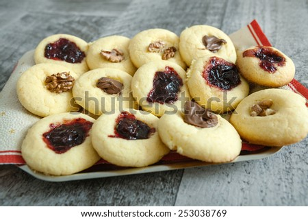 Fresh homemade pastries with jam, chocolate, and pecan - stock photo