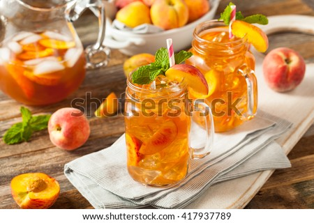 Fresh Homemade Peach Sweet Tea with Mint - stock photo