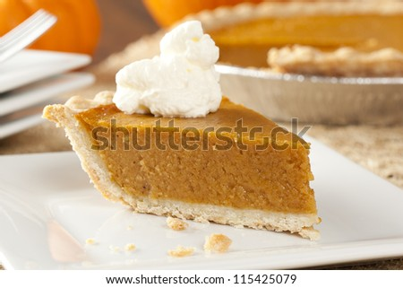 Fresh Homemade Pumpkin Pie made for Thanksgiving - stock photo