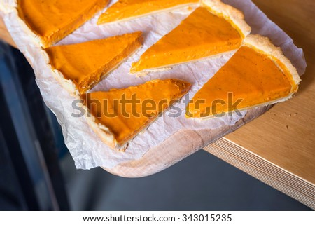 Fresh Homemade Pumpkin Pie made for Thanksgiving on crumpled paper - stock photo