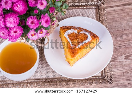 Fresh Homemade Pumpkin Pie with chrysanthemum  on wooden background - stock photo