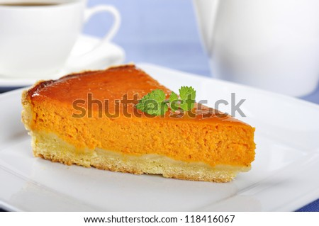 Fresh Homemade Pumpkin Pie with mint on white plate