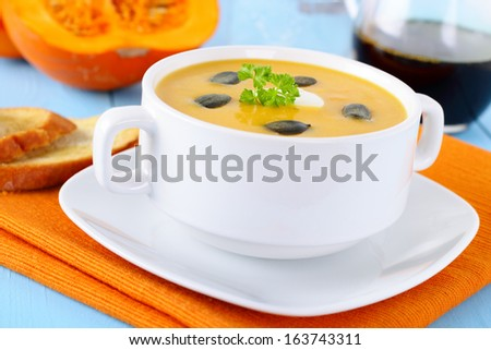 fresh homemade pumpkin soup with bread