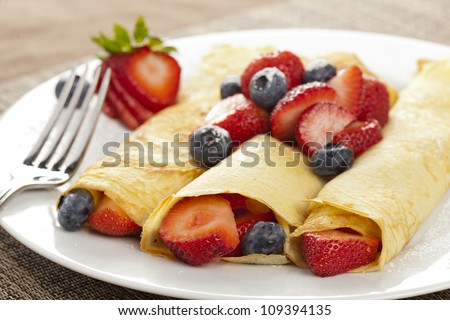 Fresh Homemade Rolled Strawberry Crepes with blueberries - stock photo