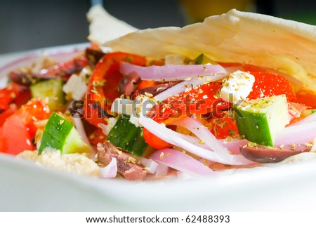 fresh homemade salad wrap on pita bread,very healthy food - stock photo