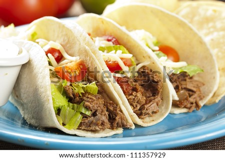 Fresh Homemade Shredded Beef Tacos with organic ingredients - stock photo