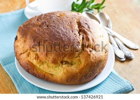Fresh homemade sweet bread on wooden background. Selective focus. - stock photo