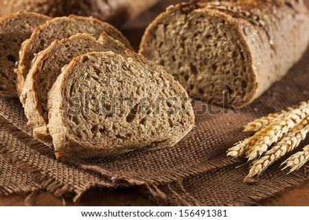 Fresh Homemade Whole Wheat Bread on a Background - stock photo
