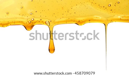 Fresh honey being poured over honeycomb pieces, studio shot - stock photo