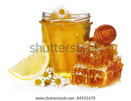 Fresh honey, chamomile and lemon on white isolated background - stock photo