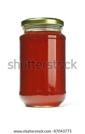 Fresh honey in glass jar on white background - stock photo