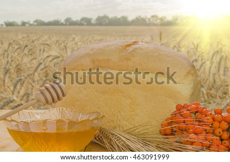fresh honey on a wooden table in a sunny weather
