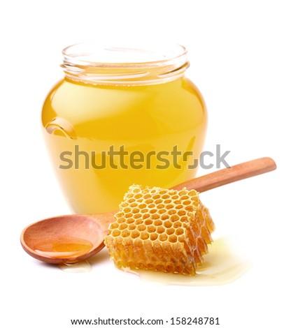 Fresh honey with honeycomb - stock photo