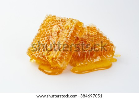 Fresh honey with honeycomb - stock photo