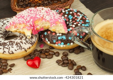 Fresh hot coffee and fresh donuts. Traditional sweets with coffee. Calorie junk food. Fresh unhealthy breakfast. fresh donuts.fresh donuts.fresh donuts.fresh donuts.fresh donuts.fresh donuts.donuts. - stock photo