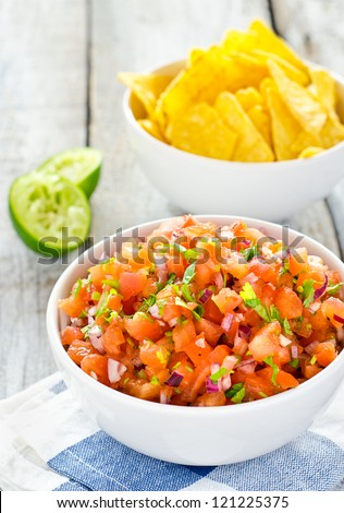 Fresh hot homemade salsa sauce with nachos - stock photo