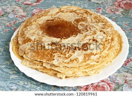 Fresh hot pancakes on white plate - stock photo