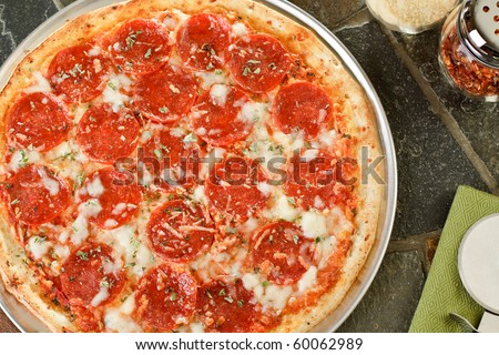 Fresh hot pepperoni pizza - stock photo
