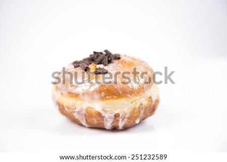 Fresh hot polish donut with chocolate, jam and icing isolated on white background - stock photo