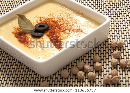 Fresh Hummus Dip Topped with Paprika and Olive - stock photo