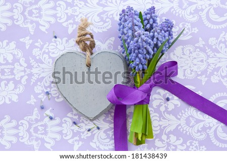 Fresh hyacinths  with ribbon and a heart on purple - stock photo