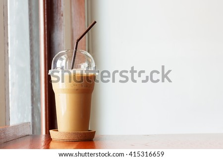 Fresh ice coffee on table in cafe with copy space.