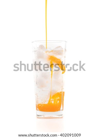 fresh, ice cold carbonated water in glass on white background - stock photo