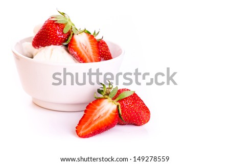 Fresh ice cream in a plate with strawberry isolated on white - stock photo