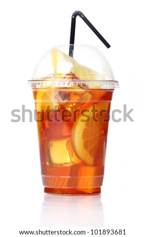 Fresh ice tea in plastic glass on white background