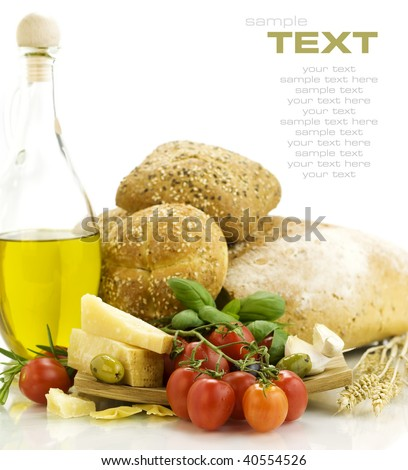 Fresh ingredients for an Italian dinner and appetizers over white. With sample text - stock photo