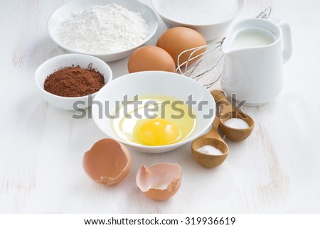 fresh ingredients for baking on a white table, horizontal, top view - stock photo