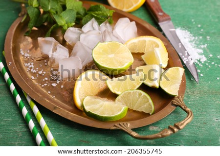 Fresh ingredients for mojito on old tray - stock photo