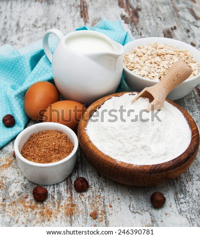 fresh ingredients for oatmeal cookies - oat flakes, eggs and milk - stock photo