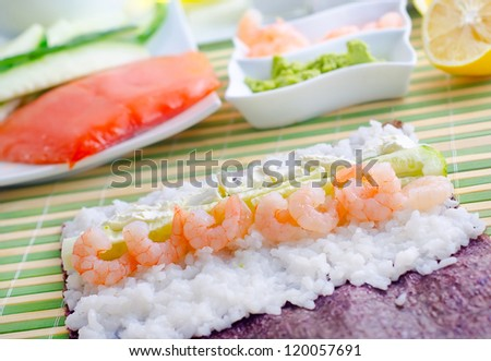 Fresh ingredients for sushi, rice and shrimps - stock photo