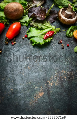 Fresh ingredients for tasty cooking and salad making on dark rustic background, top view, frame. - stock photo