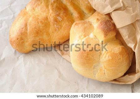 Fresh Italian bread  in an envelope baker  - stock photo