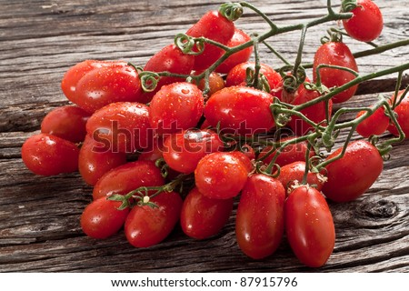 fresh italian cherry tomato on wood - stock photo