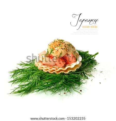 Fresh Japanese crab sticks on shellfish shells with dill and seafood sauce against a white background. The perfect image for a fish restaurant or dinner invitation design. Copy space. - stock photo