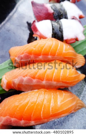 Fresh japanese salmon sushi on dish
