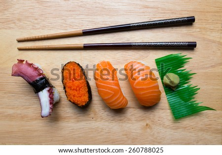 Fresh japanese sushi with wasabi on wood background - stock photo