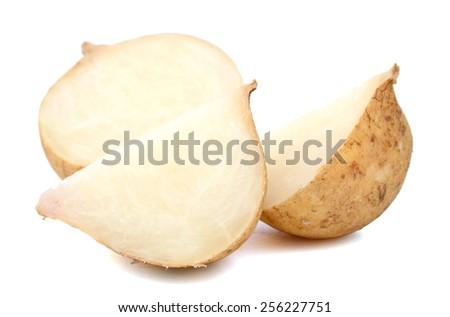 fresh jicama cut in slice on white background  - stock photo
