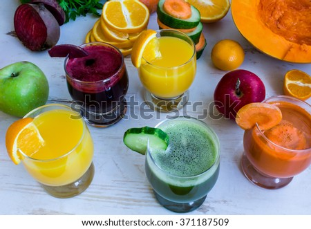 Fresh juice: cucumber juice, orange juice, beet juice - stock photo
