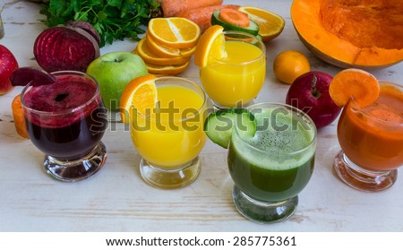 Fresh juice from beet, carrot, cucumber, squash. Vegetable fresh juices and citrus fruit juices. Fresh orange juice. Vegetables and fruit on the table - stock photo