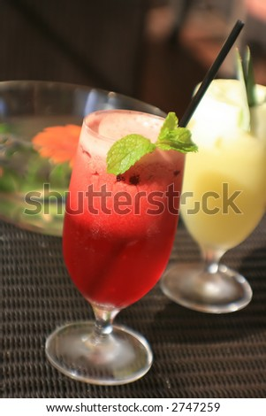 fresh juice in glasses on a table - stock photo