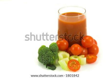 Fresh juice made from assorted fruit and vegetables including tomato, celery and broccoli against with background with copy space - stock photo