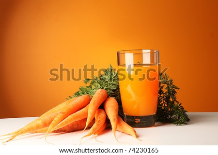 Fresh juice made from carrots - stock photo